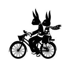 I seem to have a thing with rabbits and bikes lately.  And here's rabbits on bikes!