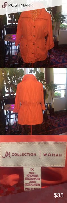 Water resistant coral anorak 3/4 length jacket. Coral 3/4 length jacket. Adjustable drawstring waist line.  Rollup snap sleeves. A cute water resistant jacket that is light weight and perfect for traveling. It goes great with jeans, leggings, shorts or a long skirt. jm collection/ women Jackets & Coats
