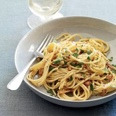 Spaghetti with Anchovy Carbonara | Chris Cosentino adds briny flavor to his pasta with cured tuna heart. He shaves it on right before serving. This recipe calls for anchovies, rather than the tuna heart Cosentino uses. Egg yolks form a silky sauce.