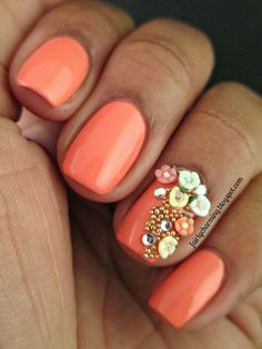 Orange nails with flower decorations