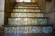 """""""A fave client had custom tiles made for her stairs. I had to have them! I figured out how to make it work using metallic paints, foils and painted glass. I was on a tight budget so my husband made custom stair risers and I wood grained them to match our wood floor!"""" (artist Julie Young)"""