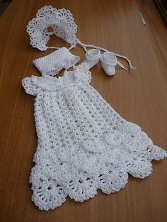 There's a new family member on the way! Celebrate the little one's arrival by creating a special christening layette. You want the best for Baby, so why not crochet one of these two classic christening sets designed by Kay Meadors? Each set includes Crochet Girls, Crochet Baby Clothes, Crochet For Kids, Crochet Outfits, Crochet Dresses, Knit Dress, Crochet Crafts, Crochet Projects, Knit Crochet