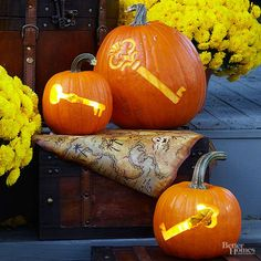 Unlock the spirit of Halloween with these eerie, old-fashioned skeleton key pumpkins.  Carve the pumpkins: Transfer the free downloadable carving patterns to your pumpkins and use a knife or carving tool to cut out the two smaller key designs. A gouging tool easily carves the large key design into your pumpkin. | DIY Fall and Halloween Pumpkin Carving and Etching | http://www.bhg.com/