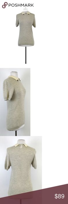 """J. Crew Collection- Grey Cashmere Short Sleeve Sweater Sz S This sweet grey cashmere sweater is soft and warm. Embellished neckline makes it easy to accessorize just add some stud earrings. Incredibly versatile, can be worn to the office or to date night! Size Small Body 100% Cashmere Slips on Buttons on back of neck Embellished neckline Shoulder to Hem 27.5"""" Give J. Crew lots of credit for staying relevant over the years, changing things up a bit and still being able to stick to their…"""
