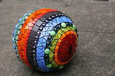 Bowling ball art!  It's a mosaic.  I want to make one for my yard!
