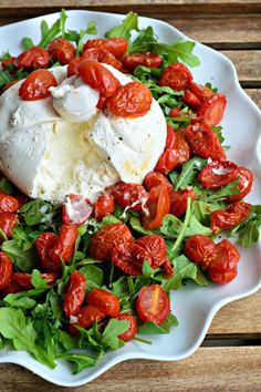 Burrata over arugula with slow-roasted grape tomatoes: a salad for everyone dreaming of summer.