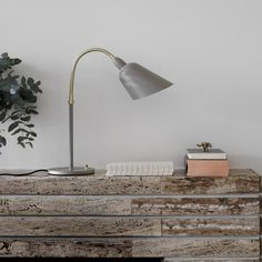 &+Tradition+Bellevue+Table+Lamp+AJ8+Brass+-+Danish+brass+table+lamp+by+Arne+Jacobsen.  First+created+in+1929,+the+honest+Danish+design+of+the+&+Tradition+Bellevue+Table+Lamp+AJ8+Brass+balances+refined+materials+with+aesthetic+authenticity.  Gracefully+formed+from+one+sheet+of+metal,+the+brass+swan+neck+and+45-degree+cut+shade+provides+a+pioneering+everyday+lighting+solution+in+the+style+of+Danish+Modernism.  A+re-launch+of+Arne+Jacobsen's+iconic+Danish+lamp,+this+designer+table+lamp+i...