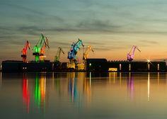 Croatian designer creates giant light show by illuminating shipyard cranes.