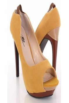 Step out on the town in this very sexy and trendy pump heels that is sure to get attention!  Be the sexy trend setter in this colorblock peeptoe pump heels!  Featuring velvet faux leather, colorblock, peeptoes, cushioned footbed, elastic back strap, and finished with smooth soles.  Approximately  1 1/4 inch covered platform and 5 inch heels.