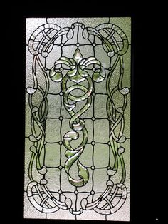 """This leaded glass panel was created to fit into a custom front door in Horse Shoe Bay, Texas. It was approx. 28"""" x 51"""" and incorporated a bevel cluster with clear textured glass in a beautiful Art Nouveau style with Celtic influence."""