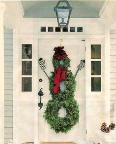 Bonhomme de neige vert en décoration de porte