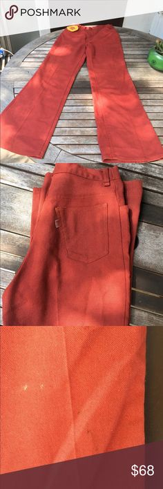 "Out of this world, vintage 70s big E Levi's Score these killer red/orange levis😍 vintage ""big E"" 1970s bell bottoms. :::::measurements laying flat::::::: waist -13.5"". Rise 13""- hips 19.5"" inseam 30.5"" theses are in incredible vintage condition, but please note small spots on knees Levi's Pants Wide Leg"