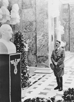 Hitler paying respects to the bust of Anton Bruckner, 1937