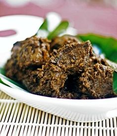 Beef Rendang: a spice-encrusted dry beef dish cooked for a long time in coconut milk. http://foodmenuideas.blogspot.com/2013/10/indonesian-food-getting-to-know.html