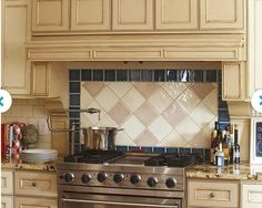 Example of framing in the area behind the cooktop using a different tile.