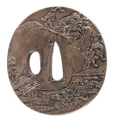 A Copper Tsuba  of circular form, cast with a battle scene with warrior figures at various tasks, signed.  Height 2 3/4 inches.