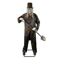 Create a creepy scene to set the tone for your Halloween party with this Home Accents Holiday Animated Grave Digger Skeleton with LED Illuminated Eyes. Halloween Graveyard, Halloween Haunted Houses, Halloween Skeletons, Halloween Horror, Halloween Zombie, Halloween Ideas, Halloween Party, Animated Halloween Decorations, Halloween Displays