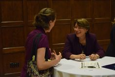 Sen. Amy Klobuchar, D-Minn., talked with a member of the audience as she signed copies of her book following her lecture Thursday night at Iowa State University. Photo by Austin Cannon/Ames Tribune http://www.amestrib.com/news/20170831/klobuchar-8216insist-on-better-way-forward8217