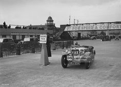 Singer sports competing in the JCC Rally, Brooklands, Surrey, 1939. Artist: Bill Brunell.Singer Sports 1935 1496 cc. Vehicle Reg. No. AWJ894. Event Entry No: 36. Place: Brooklands. J.C.C. Rally. Date: 25.3.39..