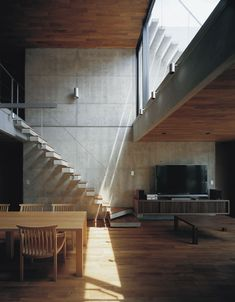 Concrete and wood in open plan.