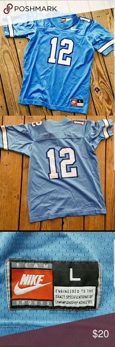 Nike youth football jersey - Sz 14/16 Nike football jersey  Sz youth L (14/16)   EUC!! No damage, stains or holes. Blue with white trim on arms. Short sleeve. ☆Smoke free home☆ Nike Shirts & Tops