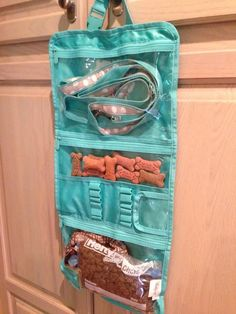 Reuse a hanging beauty bag to store and organize pet supplies while traveling