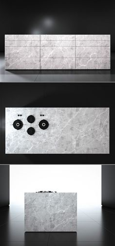 Monolith kitchen from piqu, a contemporary stone island designed to appear as one solid piece of stone. Low plinth, mitred edge details and surface mounted Pitt burners all create the overall effect. Shown here in Eclipso Bianco Granite.: