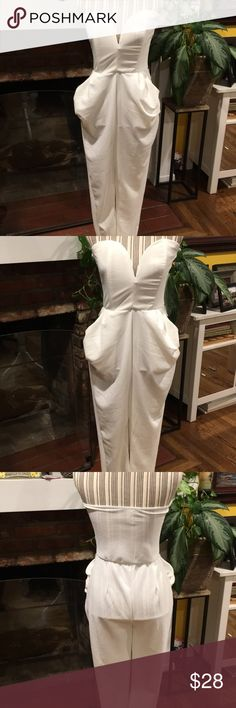 SEXY JUMPSUIT!!! NWOT This jumpsuit gives the WOW 😲 factor! So SEXY and body flattering! Pants Jumpsuits & Rompers