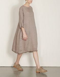 Eka's beautifully detailed, minimal handwoven linen pieces are lovely on the skin. They are comfortable and airy as dresses in Summer and also great layered over pants.
