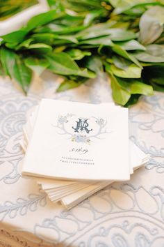 Cocktail hour napkins with custom monogram for Cincinnati wedding in blues. Custom monogram in blues with antler motif. Poeme is a stationery boutique located in Cincinnati, Ohio and serve couples all around the world. Get in touch with Kristen www.poeme-online.com (513) 321 - 4999.