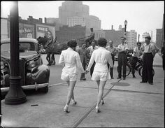 Two women, who wear shorts in public for the first time, draw male attention and cause a car accident, Toronto, 1937.
