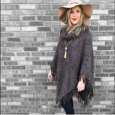 Gorgeous brown poncho Brand new! Runs true to size but can worn by a small or large as well Sweaters Shrugs & Ponchos