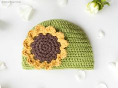 """""""Learn how to crochet this adorable Sunflower Baby Hat with an easy to follow tutorial to help add some sunshine and joy to even the gloomiest of days!"""""""