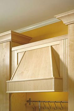 A Tapered Wood Hood melds seamlessly with cabinetry for a more traditional take on ventilation - Schrock Cabinetry
