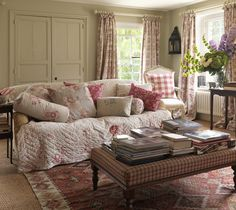 I love this room! It makes you just want to curl up with one of those books on the ottoman