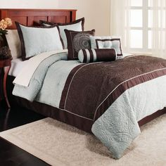 """Genovia Quilt Top 7 Piece Comforter Set $130 on sale This elegant quilted top 7-piece set in light blue and cocoa colors is outline quilted, pieced and generously filled. Shams are flanged. Bed skirt is a 15"""" drop. 3 decorative pillows complete the ensemble and are detailed with dress maker details of quilting, piecing and outline quilting. The decorative pillows are a 14"""" square, 16x20"""" breakfast, neckroll 6x15""""."""