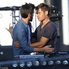 Getting close: Zac Efron looked like he was leaning in for a kiss with costar Wes Bentley ...