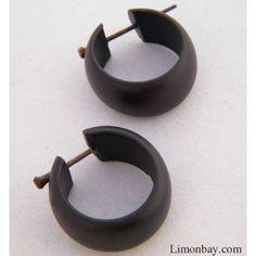 Pendientes de madera de coco. El par. Circular en maderas de distintos tonos…