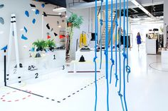 You Are Over The Line concept store Design You Are Here Eindhoven, The Netherlands. Interior by: Floor van Doremalen, Eline Ceelen, Pieteke Korte en Noesha Hu.  the store's goal — which changes every season — is to bring genderless clothing and wares to shoppers, with a specific focus on sports. various equipments and graphics spontaneously arranged provide a semi-chaotic environment perfect for the brand's current non-conformist theme. Photography by Daantje Bons.