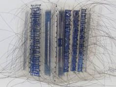 Claire-Satin transparencies, beads, monofilament creatinbg a beautiful stiched artists book.  Show at Abecedarian--one of the most interesting places that shows artists books!