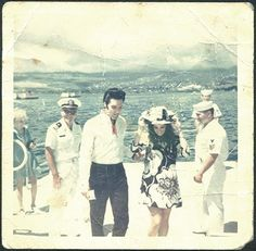 Elvis and Priscilla arriving at the USS Arizona Memorial in Pearl Harbor on Memorial Day, May 27, 1968. The woman in the background is Joan Esposito. She's carrying Priscilla's purse. Elvis has a brochure for the USS Arizona in his hand.