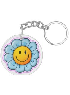 """Never leave home without your Smiley Riley Sunflower keychain - attached to your bag, pencil case or keys. Designed to withstand daily wear and tear, this keychain has vibrant clarity and brilliant colors. The keychain is 2"""" in diameter, UV resistant and waterproof - with the Smiley Riley Sunflower on both sides. A great gift. Suggested age range 5-12 years. Just For Fun, Take That, You Bag, Daily Wear, Smiley, Clarity, Keys, Best Gifts, Vibrant"""