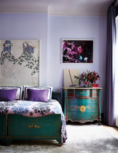 Lilac walls Take a peek inside Prinkshop's Pamela Bell's stunning East Village townhouse, and get inspired by her salon-style walls and array of colorful accents. Head to domino for home tours, decor inspo, and more. Lilac Bedroom, Lilac Walls, Lavender Walls, Purple Bedrooms, Bedroom Decor, Bedroom Ideas, Bedroom Inspo, Light Purple Walls, Pretty Bedroom