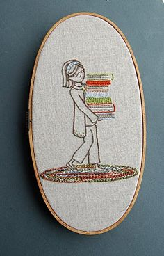 """lots of cute embroidery patterns -  basis of a """"book quilt"""" - enbroidered squares among pieced blocks"""