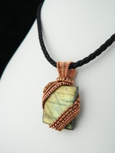 Check out this item in my Etsy shop https://www.etsy.com/uk/listing/385322522/labradorite-pendant-rectangle-cabochon