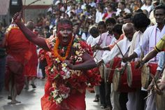 A Hindu priest performed rituals amid the Deodhani festival, which celebrates the serpent goddess, at Kamakhya Temple in Guwahati, India, Sunday. Animals are sacrificed during the festival. (Anupam Nath/Associated Press): Aug. 18 - Photo Journal - WSJ