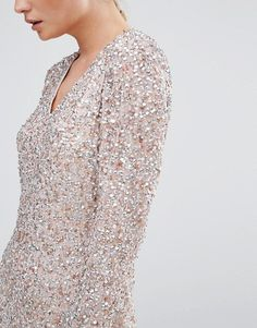 Coast | Coast Bella Dress in Sequin with Plunge Neck Heavily-embellished woven fabric V-neckline through to back Tie back fastening Zip back closure Regular fit - true to size Dry clean 100% Polyester