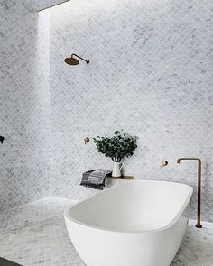 """1,982 Likes, 15 Comments - Hunker (@hunkerhome) on Instagram: """"Cover your bathroom in floor-to-ceiling marble tile for a feeling of luxury.…"""""""