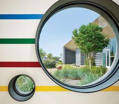 Circular windows, or at least windows at adult and kid heights to create interesting views