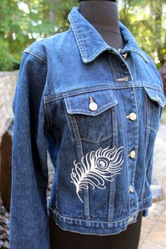 From our Caraut-Altered collection of upcycled jean jackets- a ladies size Medium jean jacket with intricate Peacock theme machine embroideries. This